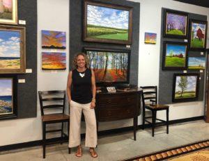 Artist Kristin Pierre with her artwork